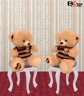 بیشترخرس عروسکی کرمی لباس راه راه سایز کوچک